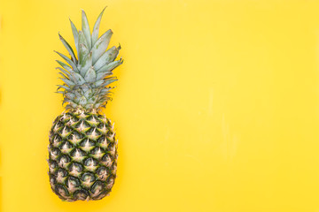 Fresh pineapple on a yellow background. Mock up