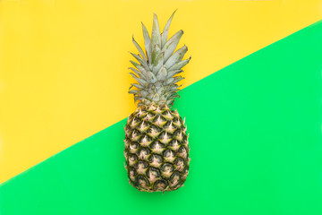 Tropical Pineapple fruit on a yellow-green background. Flat lay