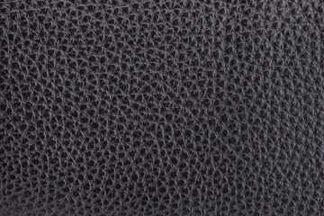 Black coarse-grained leather close-up. Fragment of black leather...