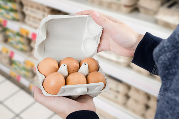 Man buys eggs in the supermarket