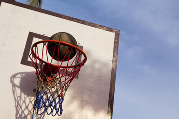 Basketball game outdoor equipment. Basket and ball. Accurate ball throw in basket.