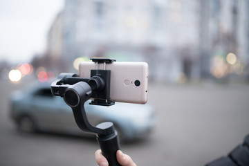 Three-axis electronic stabilizer for smartphone
