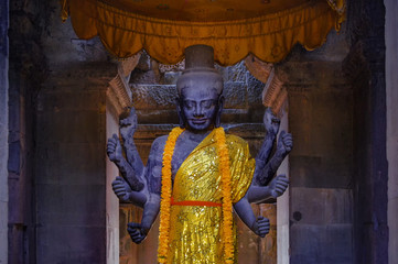 Buddha statue in one of the temples of Angkor Wat in Siem Reap, Cambodia.