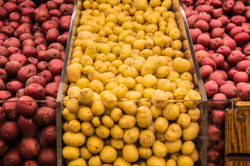 Variety of potatoes in grocery store produce bins