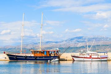 Sailing and fishing boats in Postira port, Brac island, Croatia