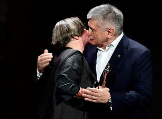 Russian filmmaker Aleksandr Sokurov kisses Polish film director Agnieszka Holland, as he receives the Lifetime Achievement Award during the 30th European Film Awards Ceremony in Berlin