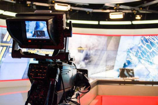 video camera lens recording show in tv studio focus on camera aperture