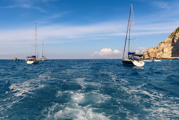 Yachts and blue waters of Navagio bay on Zakynthos island, Greece