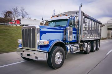 Dump truck on highway new truck chrome