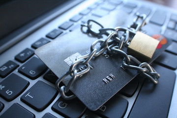 Cyber Security With Chain Around Credit Card With Gold Lock On Computer Keyboard High Quality