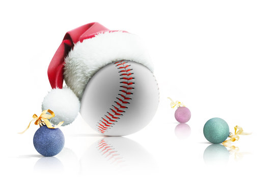Christmas baseball. Baseball ball in Santa hat Christmas toys on white background. Isolated