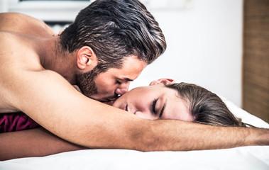 Couple kiss in bedroom