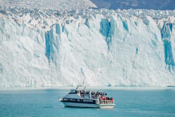 View of glacier Perito Moreno in Patagonia and touristic boat