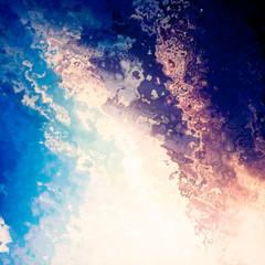 Bright light splash blue sky