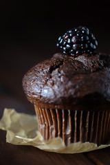 Chocolate muffin decorated with blackberry.