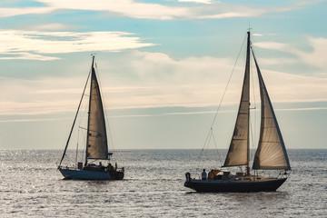 Sailboats traveling by Baltic sea