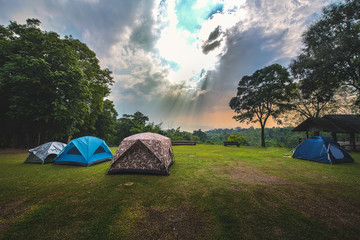 Camping tent with light sunrise morning