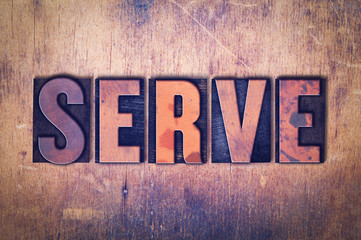 Serve Theme Letterpress Word on Wood Background