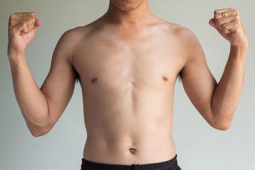 skinny boy on gray background