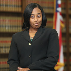 Portrait of a young attractive African America woman. Woman lawyer in law library.