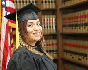 Successful young woman, portrait of a Hispanic college graduate.
