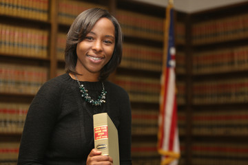 Women's Rights is Civil Rights, Portrait of a young attractive African American woman. Portrait of a woman attorney.