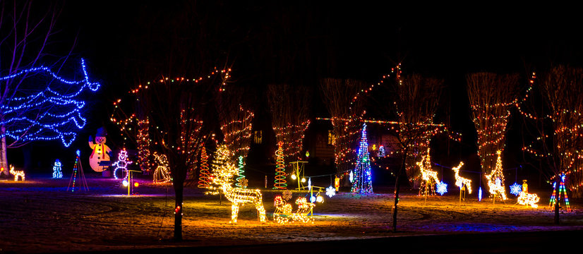 A Christmas light display in the front yard of a home on the drive of lights tour.