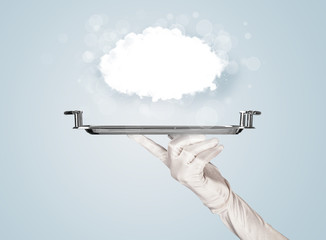 Hand holding clear big cloud on tray