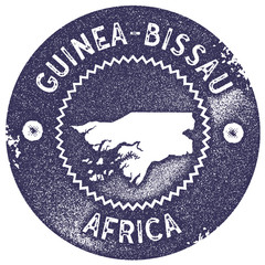 Guinea-Bissau map vintage stamp. Retro style handmade label, badge or element for travel souvenirs. Deep purple rubber stamp with country map silhouette. Vector illustration.