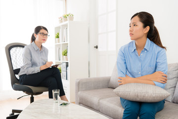 woman sitting on sofa recalling bad suffering