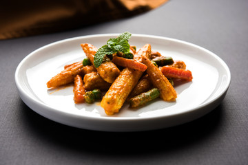 Indian Baby Corn Masala or spicy Baby corn curry served with roti or naan or indian bread