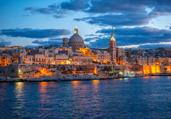 beautiful european landscape with Basilica Our Lady Mount Carmel to Valletta from Sliema, Malta