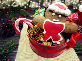 christmas cookies gingerbread and decoration on wooden background