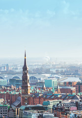 Aerial view of HafenCity, Church of St. Catherine and downtown. Hamburg, Germany