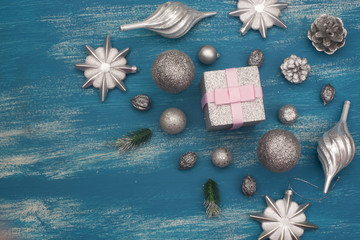 Christmas background Decorative Composition Shiny toy painted on a wooden background.