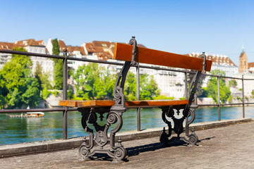 Wall Mural - Empty bench at the Rhine embankment in Basel