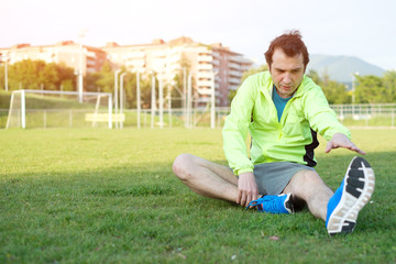 Sportsman doing exercises in a soccer field