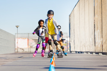 Happy inline skaters rolling at skate park