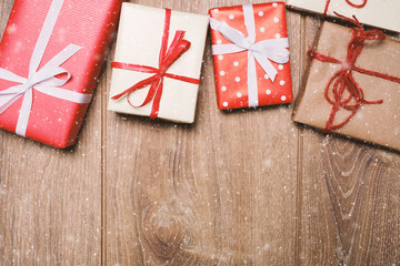Christmas presents in decorative boxes on wooden background