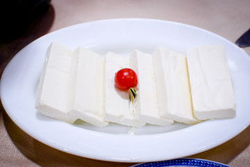 Mozzarella and cherry tomato served in an individual plate for aperitive