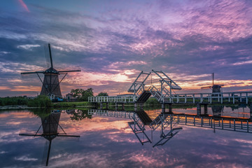 Dutch windmill by the river Netherlands