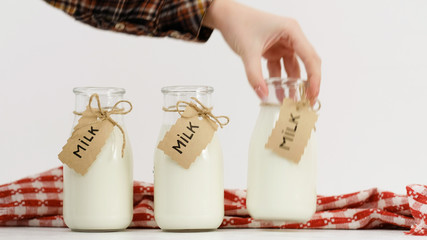 woman hand choosing milk. Only best quality for her family. Market dairy assormement
