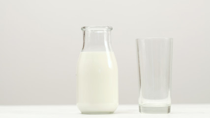 Glass bottle full of milk on white background. Organic dairy. Natural drink healthy lifestyle. Copy space concept