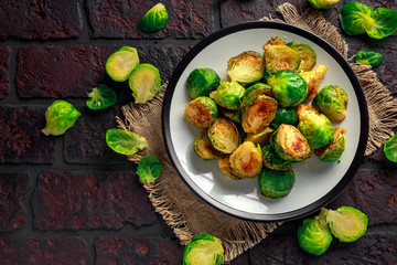 Homemade Roasted Brussel Sprouts with Salt, Pepper on a old stone rustic table.