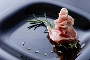 Prosciutto with thyme and rosemary.