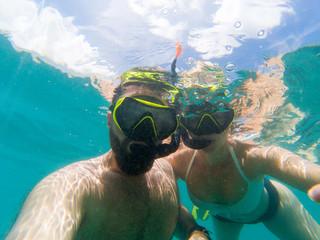 Caucasian couple snorkling