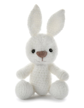 Cute knitted toy bunny on white background