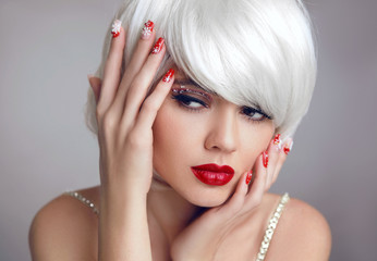 Christmas makeup. Red lips Makeup. Beautiful blonde girl closeup portrait. Manicured nails. White Short bob hairstyle. Sensual blond woman with xmas eye shadow. Vogue style.