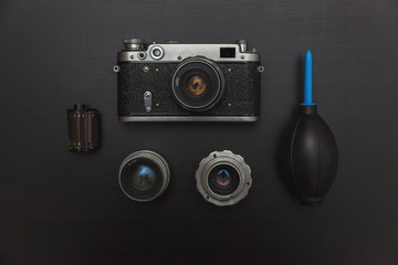 Vintage Film Camera And Accessories On Black Wooden Background Technology Development Concept. Top View