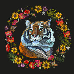 Embroidery tiger and flowers. Portrait of beautiful tiger and red roses template for fashion clothes, textiles, t-shirt design